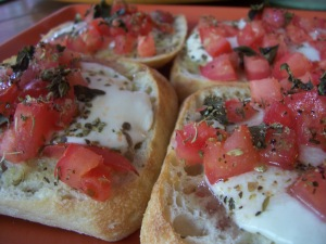 ciabatta bruschetta with fresh mozzarella and tomatoes and basil from the garden